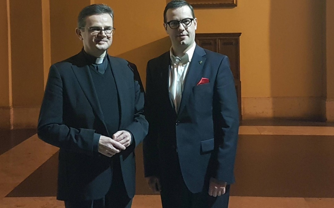 A meeting with the Reverend Monsignor in Rome.
